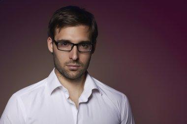 Portrait of handsome smart businesslike Financier or agent or manager in eyeglasses and white shirt