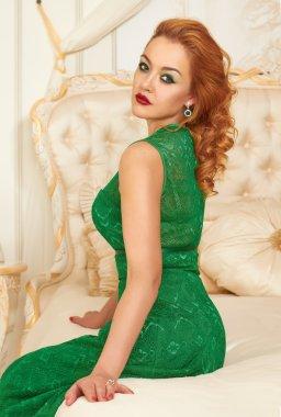 Beautiful woman in evening dress and diamond earrings