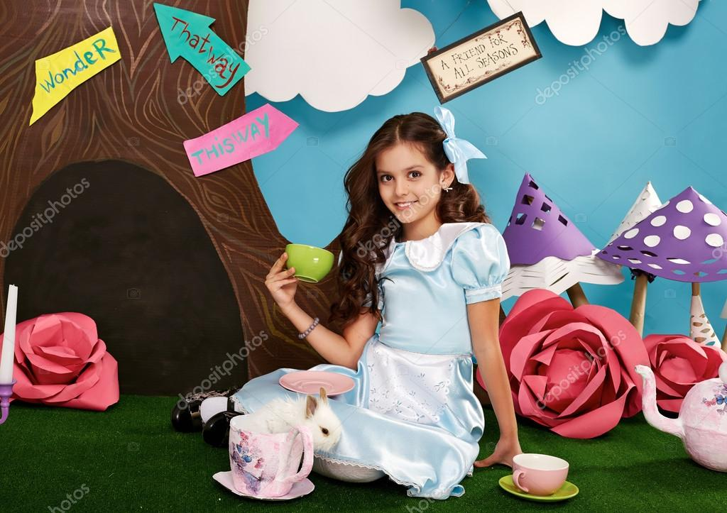 Beautiful little girl long hear blue dress with rabbit