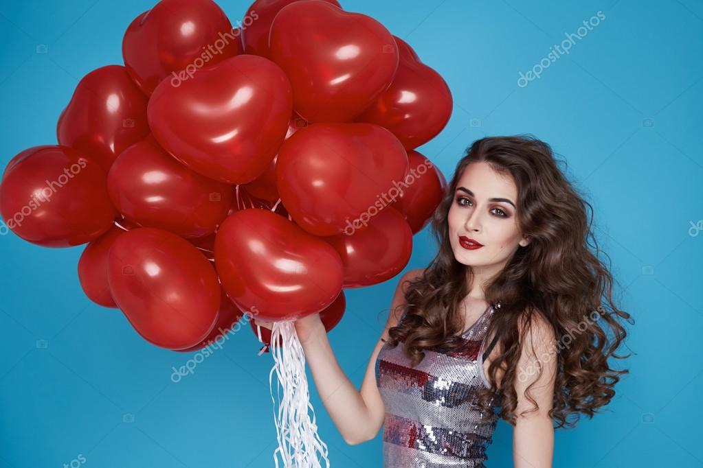 Beauty sexy woman with red heart baloon Valentines day birthday