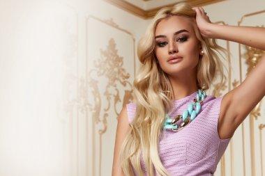 Beautiful sexy woman blond hair pink evening dress acsessory
