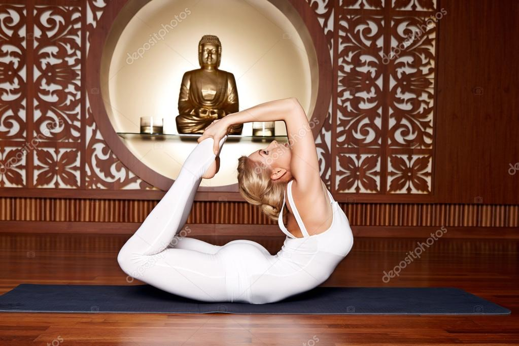 Beautiful woman yoga pilates gymnastics meditation Buddha