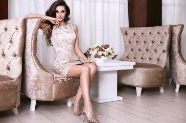 Beautiful sexy woman luxary dress jewelry make-up interior