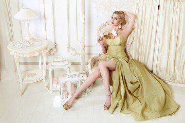 Beautiful sexy blond woman  in evening dress
