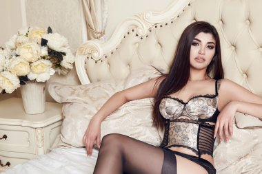 Beautiful sexy woman brunette in lace lingerie makeup body shape