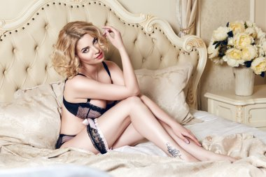 Beautiful sexy woman blond in lace lingerie makeup body shape