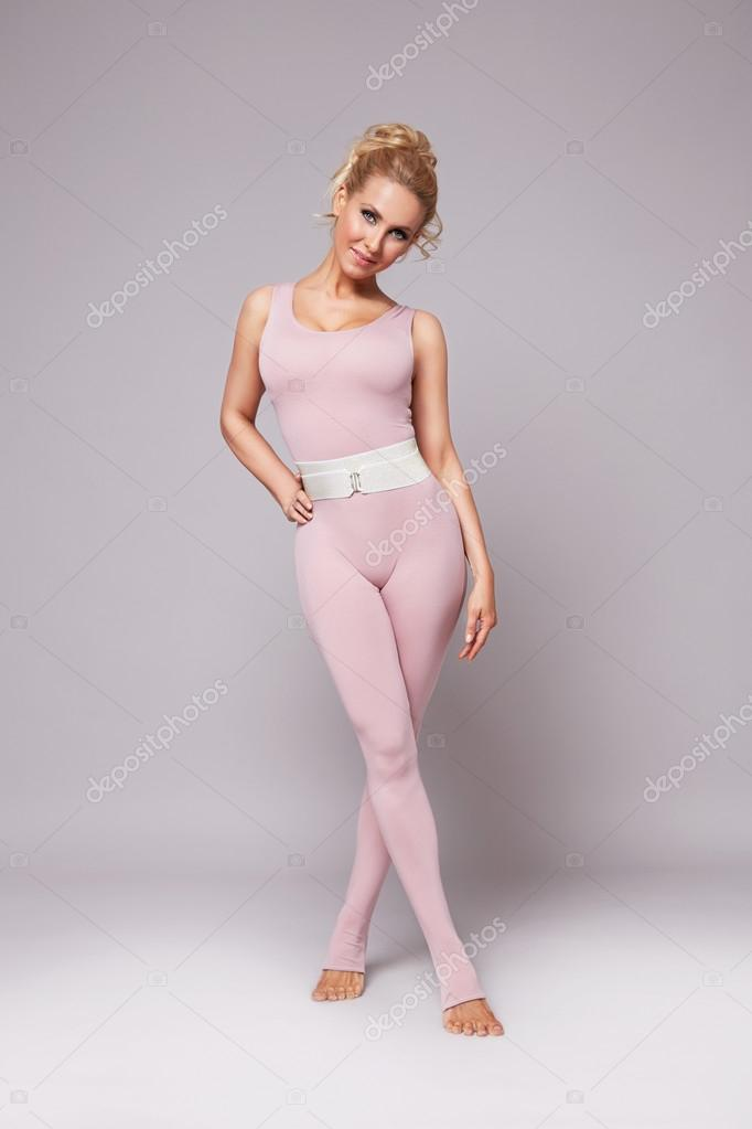 Beautiful Sexy Blonde Woman Perfect Athletic Slim Figure Engaged In Yoga Exercise Or Fitness Lead Healthy Lifestyle Eats Right Dressed Comfortable