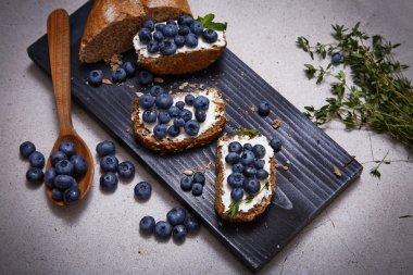 Tasty healthy food bread cream cheese blueberry juicy organic