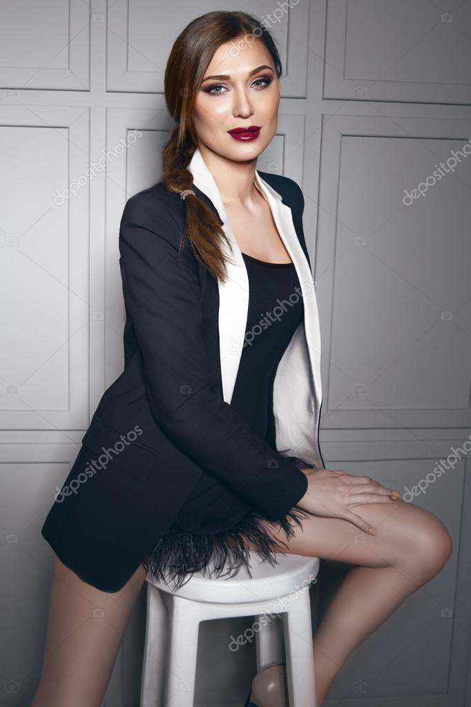 b362dd505c4 Beautiful young sexy brunette woman wearing a short dress stylish design  and fashionable jacket with white border, beige heels shoes long thin legs,  ...