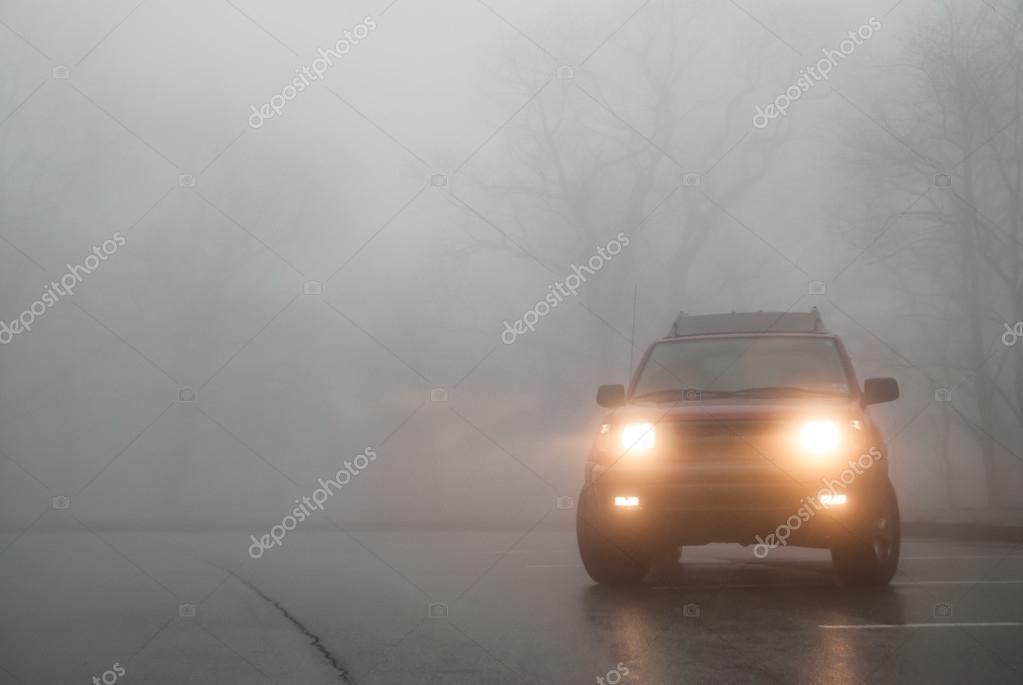 Medium Shot of SUV Lights in the Fog