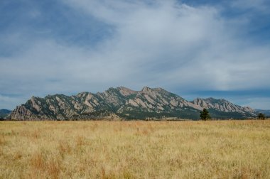 Flatiron Mountains with Dry Grassy Field