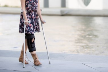 close up of woman with crutches