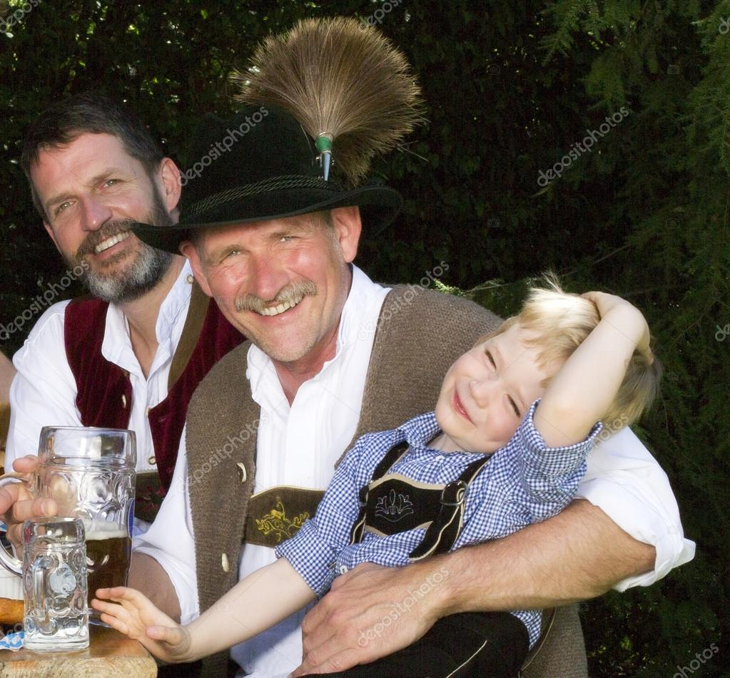 Two bavarian men and a boy