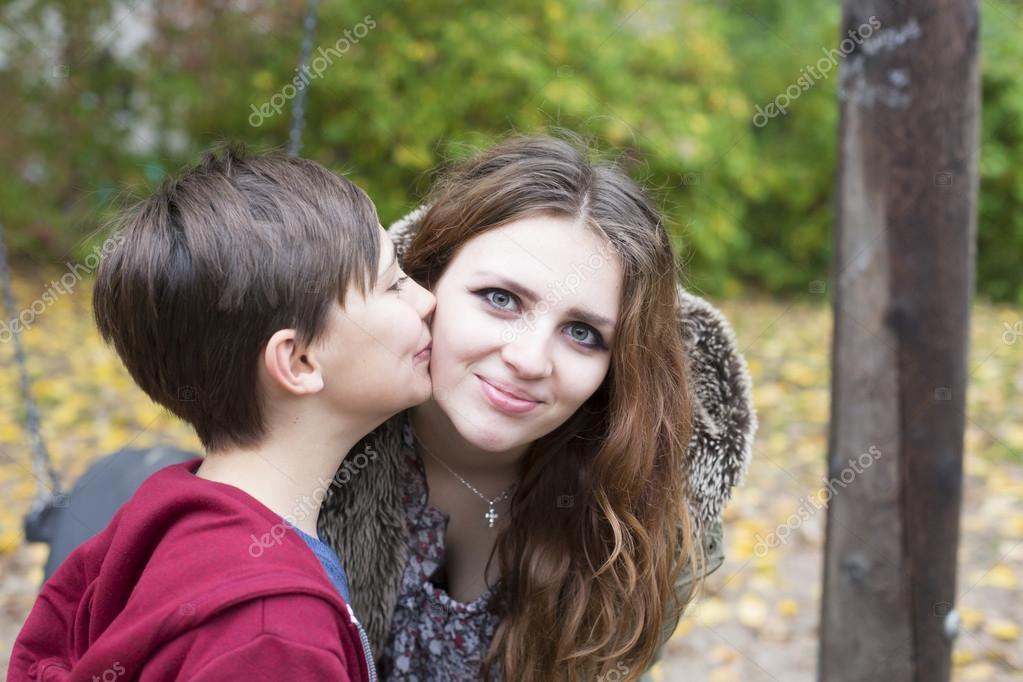 Boy Kissing Teenage Girl On Her Cheek  Stock Photo 55676935-3765