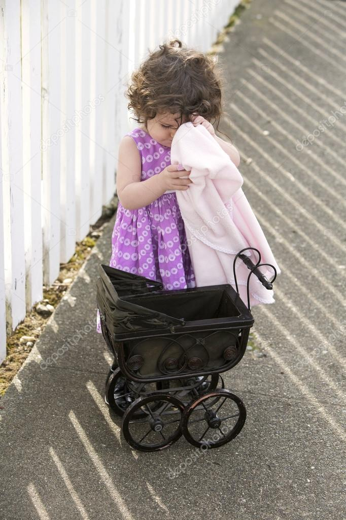 2a9653003 little girl with vintage stroller — Stock Photo © wernerimages  62113963