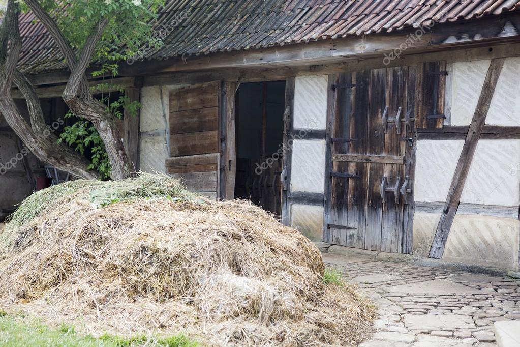 Old Wooden Barn Doors With A Haystack Stock Photo Wernerimages