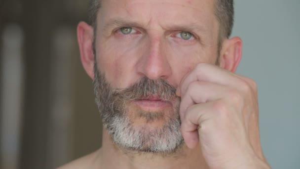 handsome man twirls his mustache