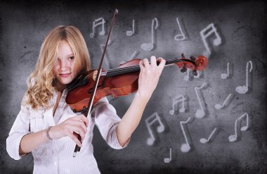 girl in front of blackboard playing the violin