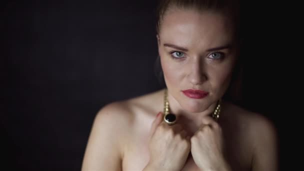 Attractive elegant woman destroying necklace jewelry