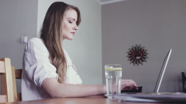 Young beautiful caucasian woman with a laptop at home.