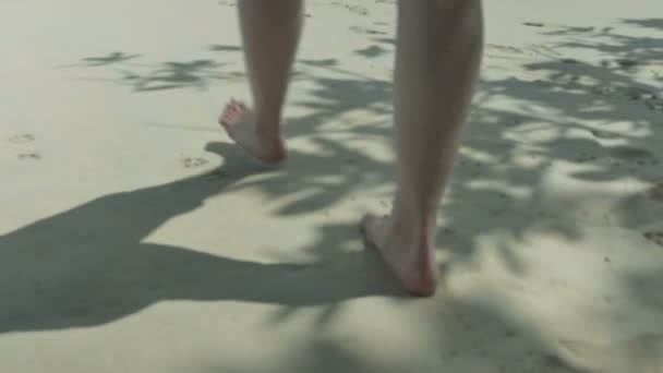 Womens beautiful legs walking on the beach.