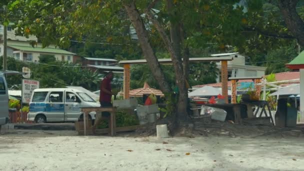Tourists and locals at Beau Vallon Beach in the west of Mahe.