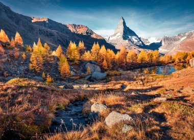 Stunning autumn view of Grindjisee lake in Swiss Alps.. Impressive morning scene of Zermatt resort location with Matterhorn (Cervino) peak on background, Switzerland, Europe. Traveling concept background
