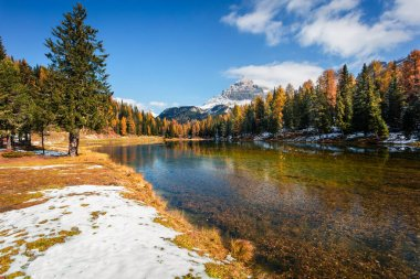 Sunny morning scene on Antorno lake. Colorful autumn landscape in National Park Tre Cime di Lavaredo, Dolomite Alps, South Tyrol. Location Auronzo, Italy, Europe. Artistic style post processed photo.