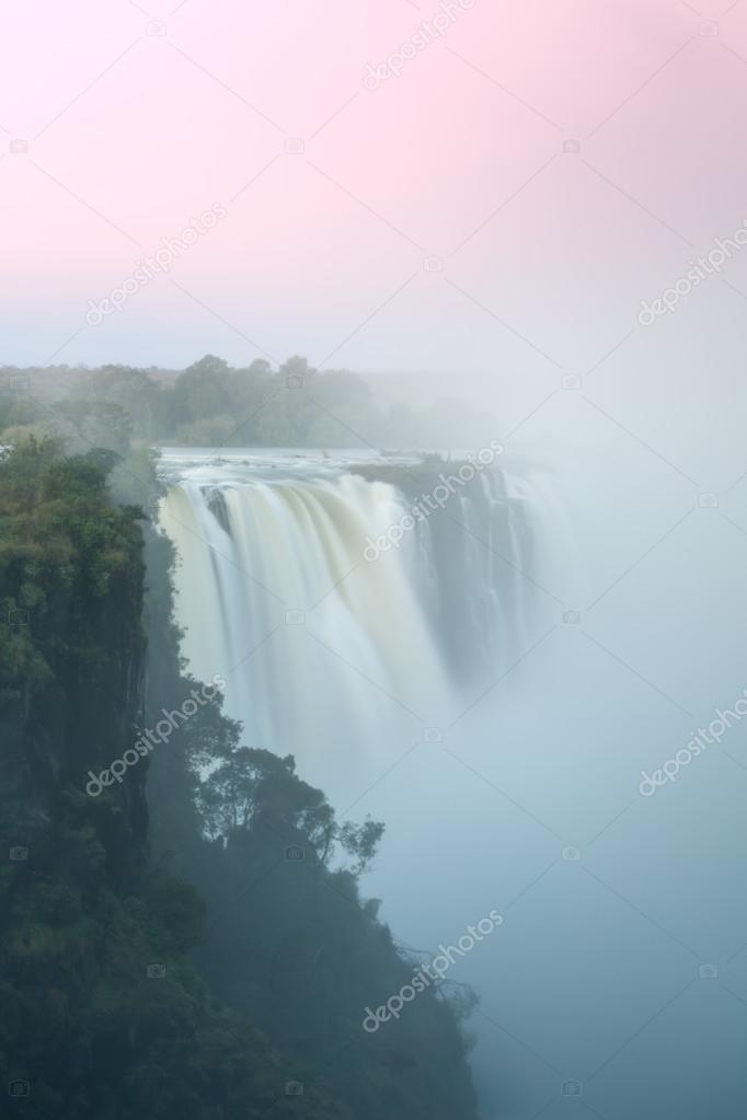 Beautiful sunset over waterfall