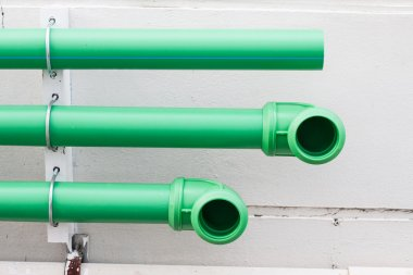 green pipes on cement wall