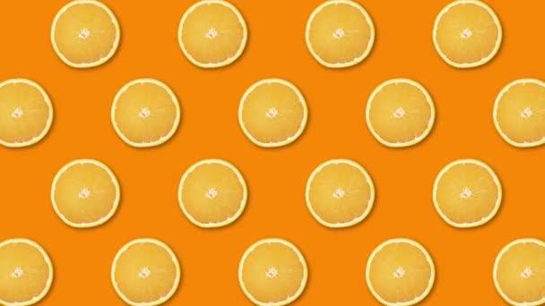 Rotating orange slices background footage. fresh orange slices.orange slices pattern.