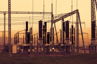 Part of high-voltage substation with switches and disconnectors, sunset