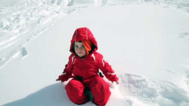 child falling in the snow and draws angel