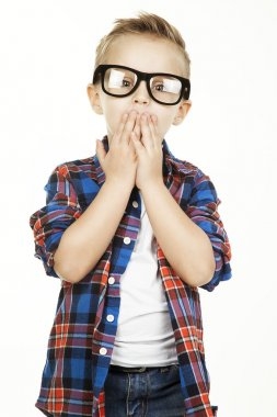 Funny child.fashionable little boy in glasses, jeans, white t-sh