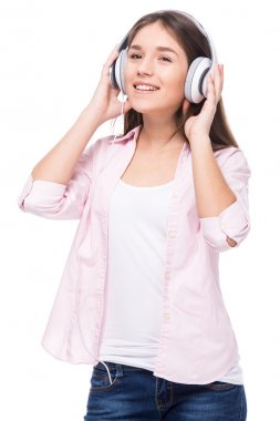 Smiling girl with headphone is listening a music, isolated on white background. stock vector