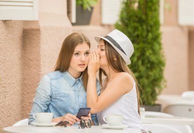 Girls in summer cafe