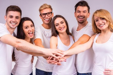 A group of young people smiling on a gray background. Studio shooting stock vector