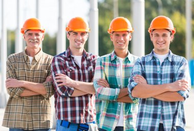 Portrait of male engineers builder in yellow helmet, office center background stock vector