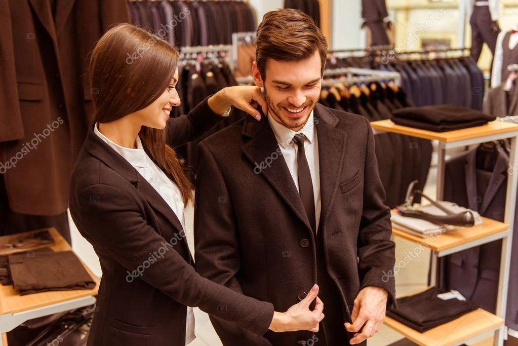 3699201644f9f Depositphotos stock photo people in suit shop jpg 1023x683 Tienda de traje