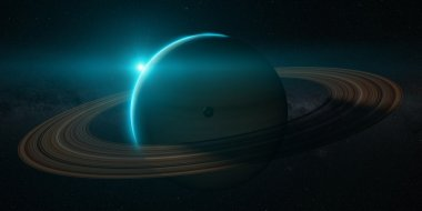 planet saturn with rings at sunrise