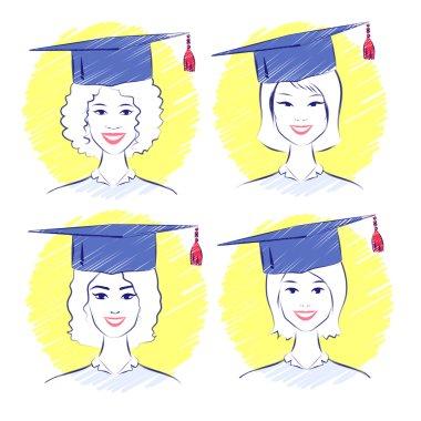 women wearing graduation caps