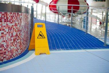 Warning of slippery floors.