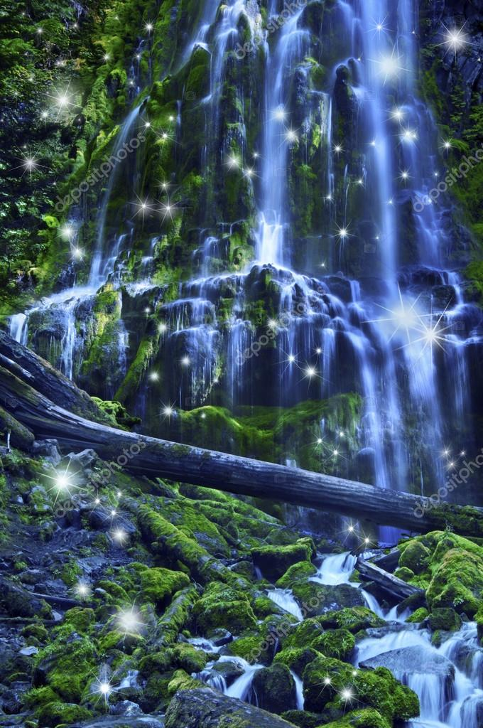 Waterfall with fairies and magical blue moonlight affect