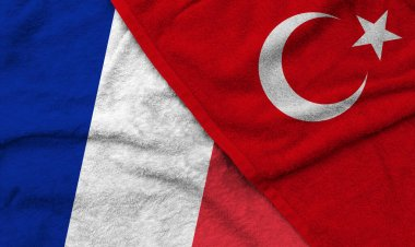 The French and Turkish flags pattern on towel fabric are placed together. It is the concept of the relationship between the two countries.