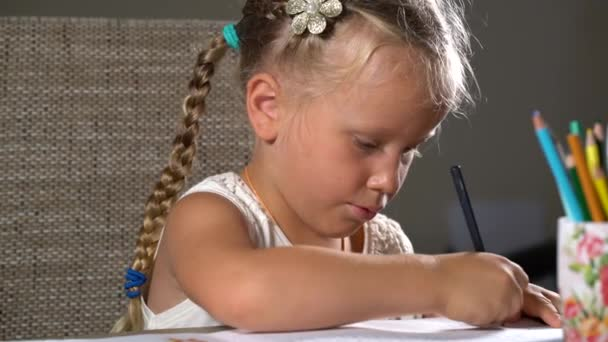 four-year girl performs educational tasks