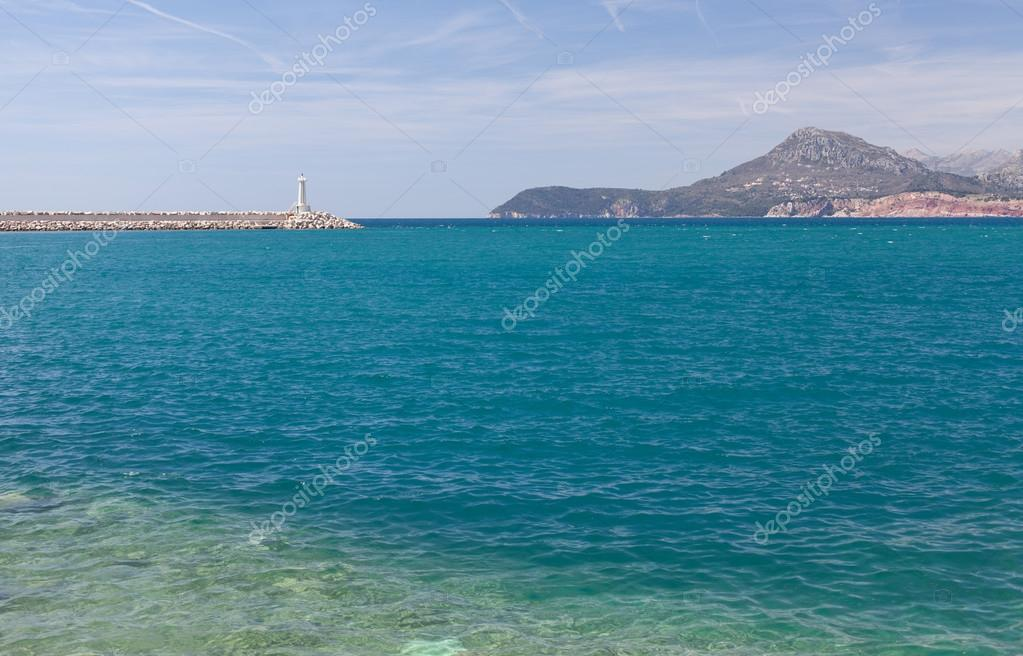Adriatic Sea, lighthouse and the mountains.