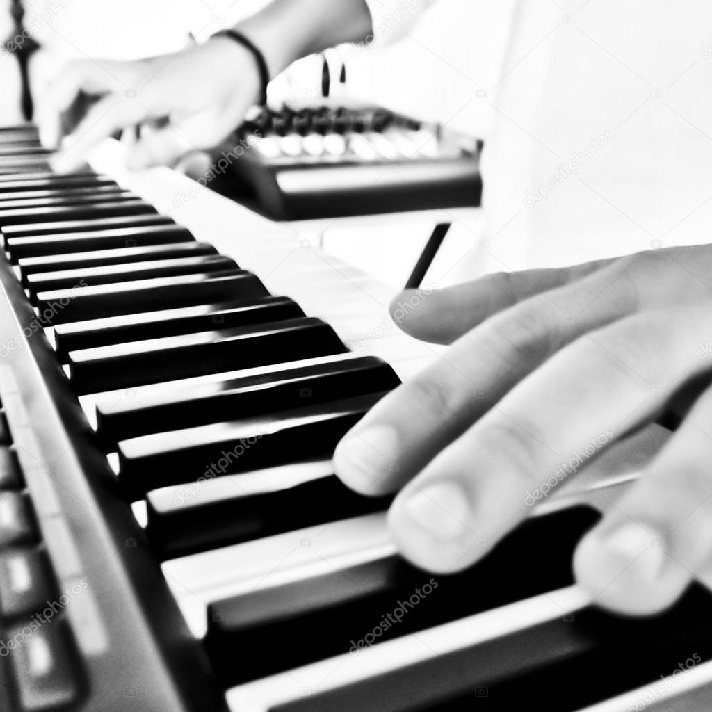 Hand playing keyboard