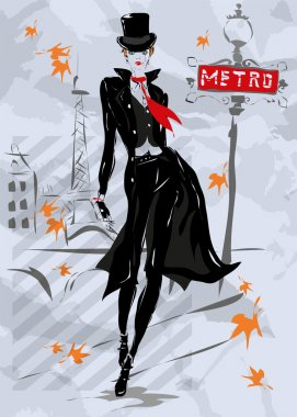 The fashionable woman goes down the street, autumn