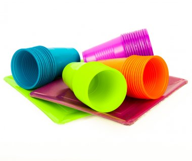 Disposable bright plastic cups and plates stacked