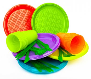 Disposable bright plastic kitchenware stacked on white
